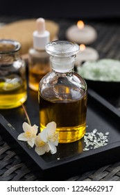 Massage oil with sea salt and Jasmine flowers. The concept of Spa and relaxation