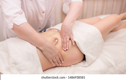Massage on the problem areas of the body for weight loss and body correction. Master massage therapist makes anti-cellulite massage to a young girl. Spa treatments relaxing massage.