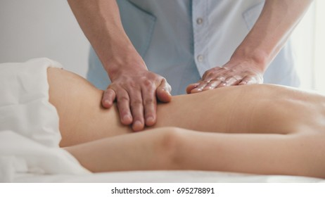 Massage parlor. Male hand close-up