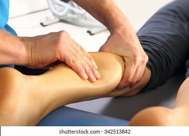 Massage and rehabilitation. Masseur massaged his calf.