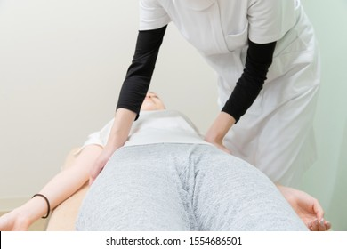 massage scene of pelvis and waist