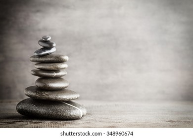 Massage stones put in the form of a pyramid.