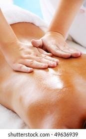 Massage Techniques II - woman receiving professional massage.