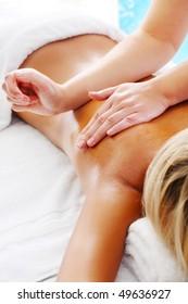 Massage Techniques V - woman receiving professional massage.