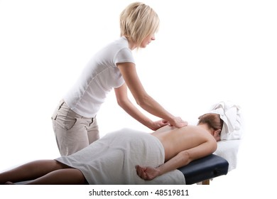 Massage therapist doing a back massage