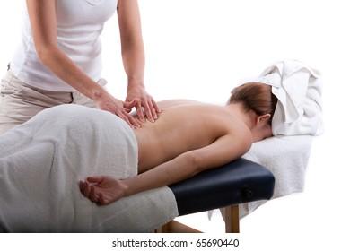Massage therapist doing a back massage