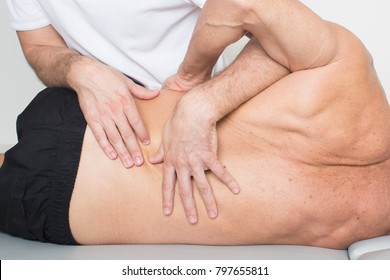 Massage therapist giving a back massage