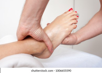 Massage therapist giving a foot massage
