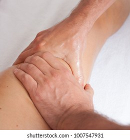 Massage therapist giving a knee massage