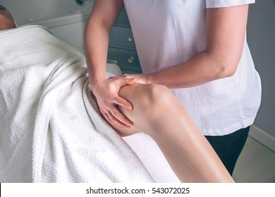 Massage therapist hands doing lymphatic drainage treatment to woman