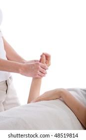 Massage therapist massaging woman's hand