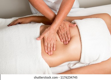 Massage Therapist Massaging a Women's Stomach