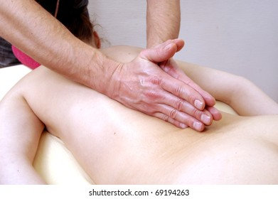 Massage therapist massaging a young woman