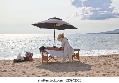 massage therapist on the beach