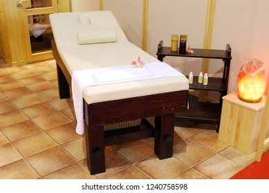 Massage treatment room with bed spa salon