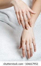 Massage of woman's hand on the white cloth