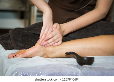 Massaging of young woman in SPA