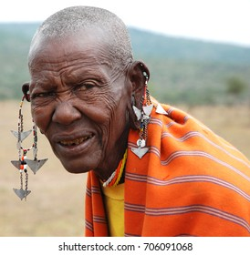 MASSAI LAND, KENYA - JULY 5, 2017: ELDERLY WOMAN OF THE MAASAI TRIBE
