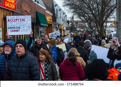 MASSAPEQUA PARK, NY - FEBRUARY 3: A large group of protesters march with signs and chant at a Travel Ban protest march outside of Rep. Peter King's office on February 3, 2017 in Massapequa Park.