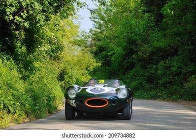 MASSAROSA, ITALY - APRIL 26: A green Jaguar D-Type takes part to the GP Terre di Canossa classic car race on April 26, 2014 near Massarosa. The car was built in 1957.