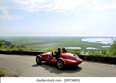 MASSAROSA, ITALY - APRIL 26: A red Fiat Gilco 1100 Sport takes part to the GP Terre di Canossa classic car race on April 26, 2014 near Massarosa. The car was built in 1948.