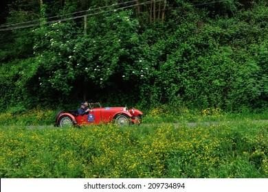 MASSAROSA, ITALY - APRIL 26: A red Aston Martin International takes part to the GP Terre di Canossa classic car race on April 26, 2014 near Massarosa. The car was built in 1929.