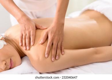 Masseur doing back massage in the spa salon