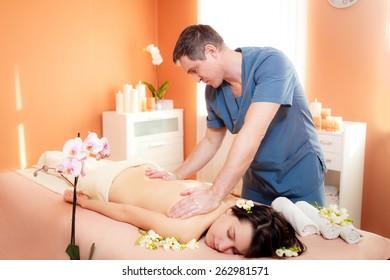 Masseur doing massage beautiful girl.  Beauty treatment concept.