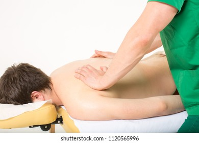 Masseur doing a shoulder massage