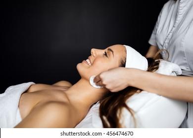 Masseur giving treatment to beautiful brunette