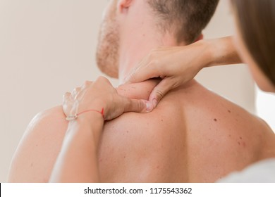 Masseur hands making relax masage.Massage therapy.Close up