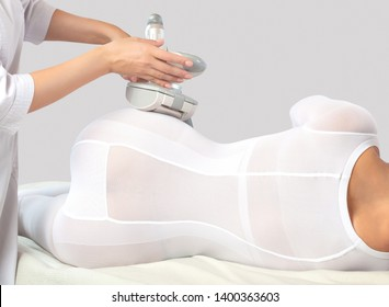 The masseur make an  hardware anti-cellulite lpg massage in a beauty salon.