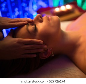 Masseur make spa procedure by candle light for woman