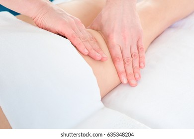 masseur makes anti-cellulite massage young woman on white background