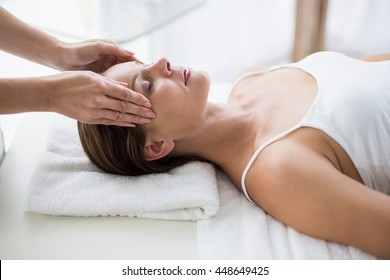 Masseur massaging woman at spa