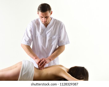 masseur. professional spa masseur massaging back of naked woman. sexy woman and handsome masseur. masseur man make massage for sexy woman. restoring her balance