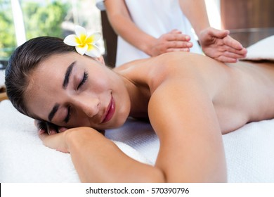 Masseuse giving massage to relax woman at spa