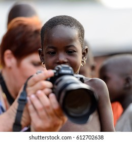 MASSIF KABYE, TOGO - JAN 13, 2017: Unidentified Togolese little girl looks into the tourist's camera in the village. Togo children suffer of poverty due to the bad economy.
