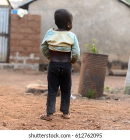 MASSIF KABYE, TOGO - JAN 13, 2017: Unidentified Togolese  little girl from behind in the village. Togo children suffer of poverty due to the bad economy.