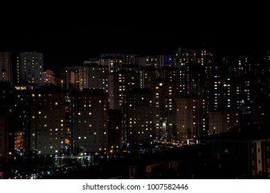Massive aparments view during the night time with its electric lights