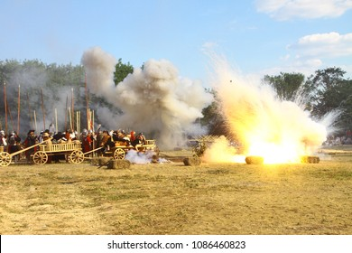 Massive bomb explosion during re-enactment of medieval battle. Blowing up on the battlefield with flame and clouds of smoke. Detonation of the cannon ball. Pyrotechnics. Living history festival.