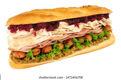 Massive Christmas dinner sandwich isolated on a white background