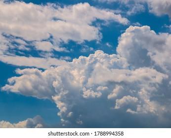 A massive cloud in the blue sky - (cumulus congestus or towering cumulus)