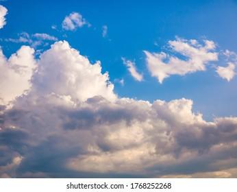 Massive clouds - Cumulus congestus or towering cumulus - on the blue sky