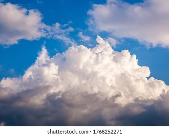 Massive clouds - Cumulus congestus or towering cumulus - forming in the blue sky