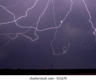 Massive cloud-to-cloud lightning event over power lines