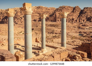 The massive colums of the Byzantine  Blue Church (Blue Chapel) against the Royal Tombs, Petra, Jordan