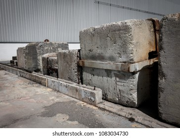 Massive concrete counterweights in an industrial storage yard