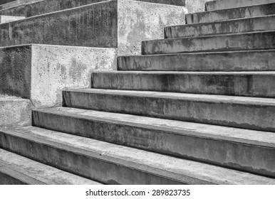 Massive concrete steps and planter boxes photographed in tones of black, white, and gray.