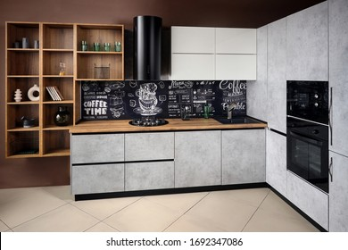 Massive cottage urban rustic loft style kitchen interior in wooden finish and granite with chalk lettering background.